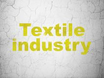 Industry concept: Textile Industry on wall background. Industry concept: Yellow Textile Industry on textured concrete wall background vector illustration