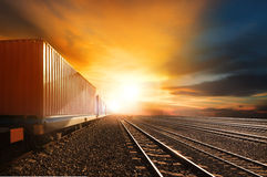 Industry container trains running on railways track against beau Royalty Free Stock Images