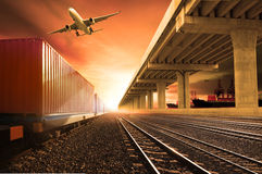 Industry container trains running on railways track  cargo plane Royalty Free Stock Photos