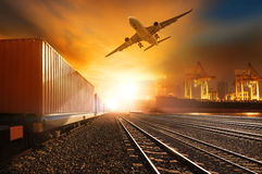 Industry Container Trainst Running On Railways Track And Commercial Ship In Port ,plane Air Cargo Flying Above Use For Land Royalty Free Stock Photos