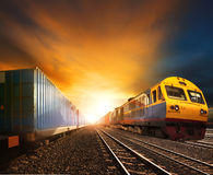 Industry container trainst running on railways track against bea Stock Photo