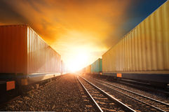 Industry container trainst running on railways track against bea Stock Photography