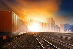 Industry container trainst running on railways track against bea Stock Photos