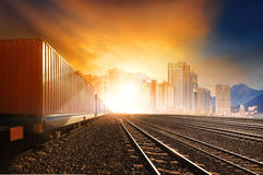 Industry container trainst running on railways track against bea Royalty Free Stock Photo