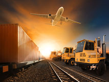 Industry container trainst running on railways track plane cargo Royalty Free Stock Images