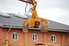 Industry crane with timber grab Stock Photo