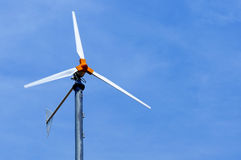 Industry electric wind turbine on blue sky backgro Stock Photo