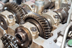 Industry gears and wheels against aluminum Royalty Free Stock Images