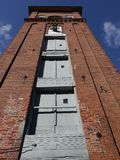 Industry: historic brick wool mill tower Stock Photo
