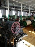 Industry: historic cotton mill machinery. Machinery in cotton weaving workshop, New England, USA royalty free stock photo