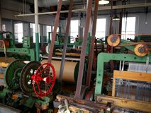 Industry: historic cotton mill machines. Spool machinery and looms in cotton weaving workshop, New England, USA stock photos