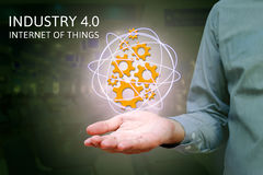 Industry 4.0, industrial internet of things concept with man show gears icons and network with factory background. stock photos