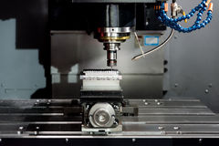 Industry machining precision part by CNC machine center working Royalty Free Stock Image