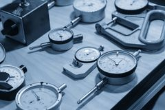 The industry measurement instrument. In the light blue scene.The various type of dial gauge for industrial instrument Royalty Free Stock Photos