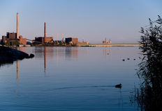 Industry near nature. Coal plant near nature. Nature is left in the shadow Stock Image