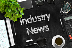 Industry News - Text on Black Chalkboard. 3D Rendering. Stock Photo