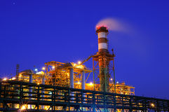 Industry at night. On a blue sky background Stock Photography