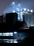 Industry at night. A night scene with a factory in an industrial area royalty free stock images