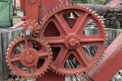 Industry - Old cogs and gears. On industrial machinery royalty free stock image