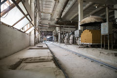 Industry. Photo of old dusty workshop at brickyard. Industry. Image of old dusty workshop at brickyard stock image