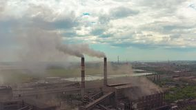 Industry pipes pollute the atmosphere with smoke, ecology pollution, smoke stacks. Industry pipes pollute the atmosphere with smoke, ecology pollution, smoke stock video footage