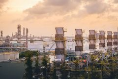 Industry plants. Petrochemical plant on yellow sky with morning time Stock Photo