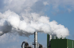 Industry with pollution vessels pipes and other equipment Stock Photo