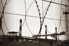 Industry and razor wire Stock Photos