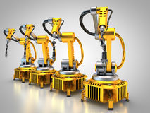 Industry 4.0. Robotic arms form a line Stock Photo
