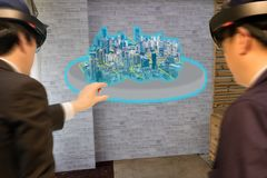 Industry smart city technology concept, civil engineer,architect blurred use augmented mixed virtual reality technology to see royalty free stock photography