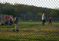 Industry Standard Galvanized Chain Link Fence At A Ball Game Royalty Free Stock Photos