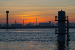 Industry sunset landscape. Industry sunset at the coast stock image