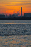 Industry sunset portrait. Industry coastal sunset near the harbor petro chemical industry stock photography