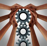 Industry Union Workers Together. Industry union and business collaboration concept as a team of diverse people turning a group of gears as company workers idea Royalty Free Stock Photos