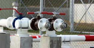 Industry valve. Gas, oil industry valves with pipeline outdoor Stock Image