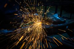 Cutting metal with angle grinder. royalty free stock photo