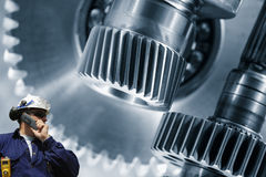 Industry worker and large gears machiney Stock Photos