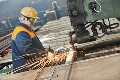 Industry worker at spot welding machine Royalty Free Stock Images