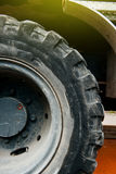 Big tractor tire. Indutrial truck detail of big tractor tire with light flare Stock Photography