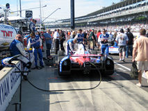 Indy Car on Pit Row. An Indy Car being prepared for the 98th running of the Indianapolis 500 mile race in 2014 at the Indianapolis Motor Speedway located in stock images
