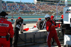 Indy car in pits getting fuel stock photography