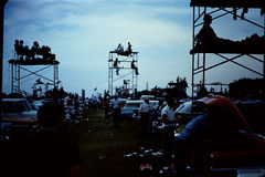 Indy 500  - Woodstock style. This is a shot from the interior of the track, watching the race.  Est 1960's Stock Photo