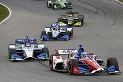 IndyCar: July 29 Honda Indy 200. July 29, 2018 - Lexington, Ohio, USA: TONY KANAAN (14) of Brazil battles for position during the Honda Indy 200 at Mid-Ohio stock photo