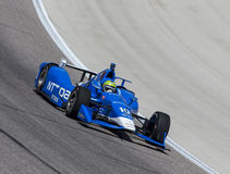 IndyCar: Jun 10 Firestone 600. Ft Worth, TX - Jun 10, 2016: Tony Kanaan (10) brings his car through the turns during a practice session for the Firestone 600 at royalty free stock image