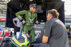 IndyCar:  May 17 Indianapolis 500. May 17, 2019 - Indianapolis, Indiana, USA: Conor Daly 25 and team owner, Michael Andretti, discuss strategy before practice royalty free stock photos
