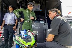 IndyCar:  May 17 Indianapolis 500. May 17, 2019 - Indianapolis, Indiana, USA: Conor Daly 25 and team owner, Michael Andretti, discuss strategy before practice stock image