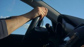 Inside a Car. A Man`s Hands on the Steering Wheel Royalty Free Stock Photo