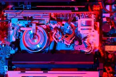 VCR inside illuminated with red and blue colors. Ine of the old VCR are illuminated from both es in red and blue Royalty Free Stock Image