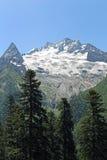 Ine Peak e montagem Dzhuguturluchat, Dombay Fotos de Stock Royalty Free