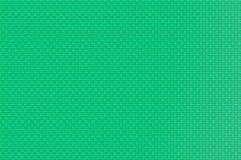 Ineengestrengeld net - turkoois en chartreuse gevormde draden Stock Fotografie